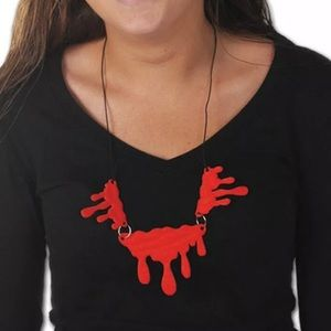 Blood dripping necklace melting vampire Halloween
